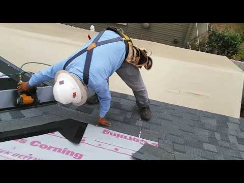 How to video : Installing new roofing shingles on a steep roof , new plywood, good video!!