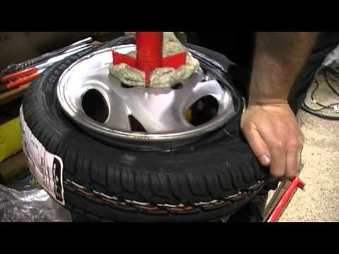 Fitting a new car tyre at home without damaging or scratching the rim