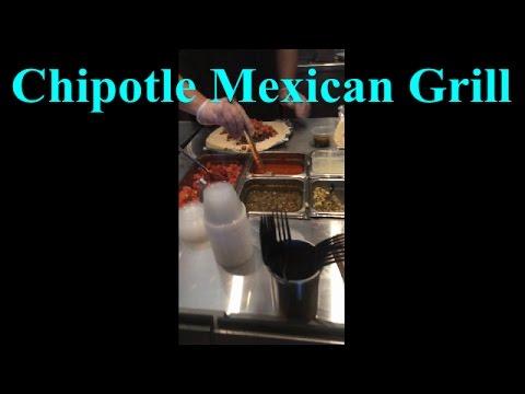 Chipotle Mexican Grill making some steak burrito