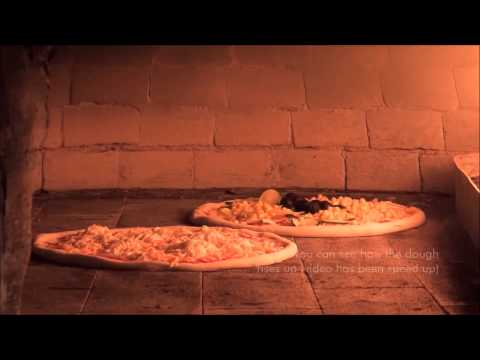 Pizza inside a wood-fired stone bread oven in pizzeria Matteo Croatia island Krk Malinska