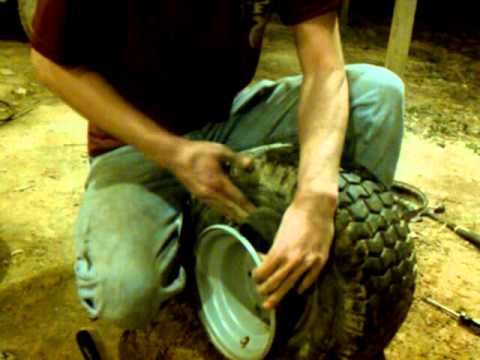 How to put a tube in a lawn mower tire