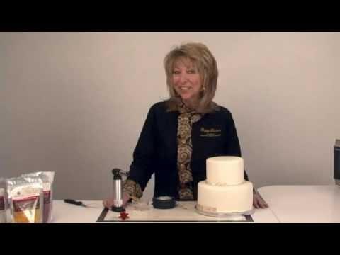 Placing CakePlay Isomalt Gems on a Fondant Cake