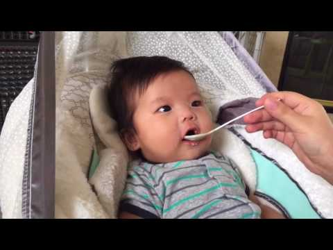 Baby eats rice cereal for the first time