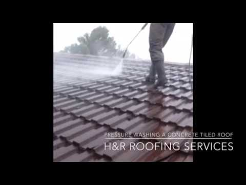 Pressure washing a concrete tiled roof