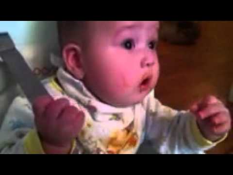 Baby trying to chew and eat his food for the first time