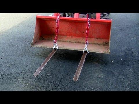 Homemade pallet forks for tractor on BX25 Kubota
