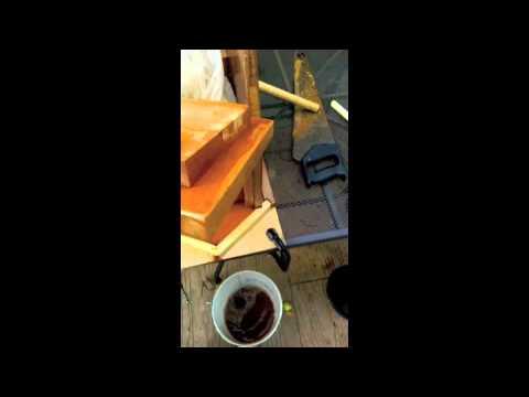 Homemade wooden fruit pulper and presser