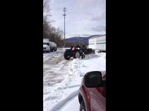 Plowing snow with tractor