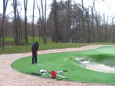 Phil Rowe chipping on artificial golf greens