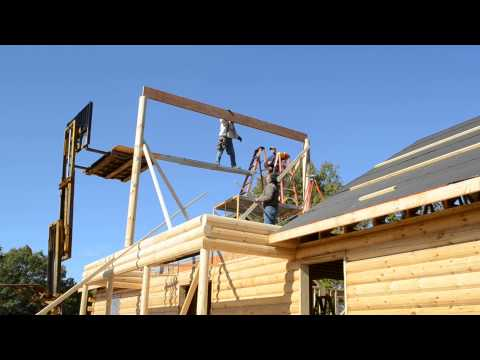 building a log home part 8. Setting a roof beam
