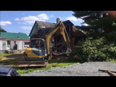 Vintage Home Being Tore Down With Small Machine