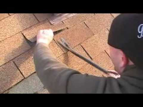 REPLACING A DAMAGED ROOF SHINGLE