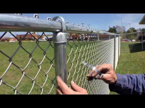 Self-Locking Fabric Bands offer a neat, professional look on residential chain link fence jobs
