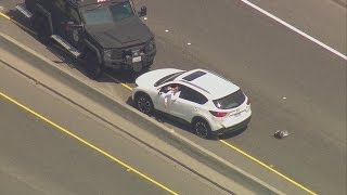 Police chase stolen car, man sips beer during standoff