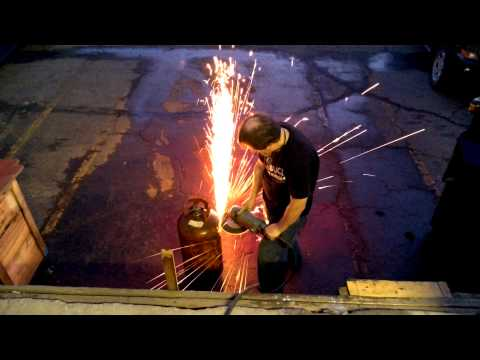 Grinding empty propane tank.