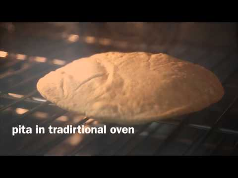 DWG gluten-free pita rising in a traditional oven