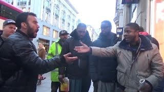 (2) Speakers Corner || Muslim Debates Hebrew Israelites || is there only 1 Quran ? - Youtube -