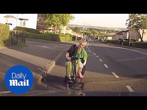 Man asleep in his mobility scooter bumps into parked car - Daily Mail