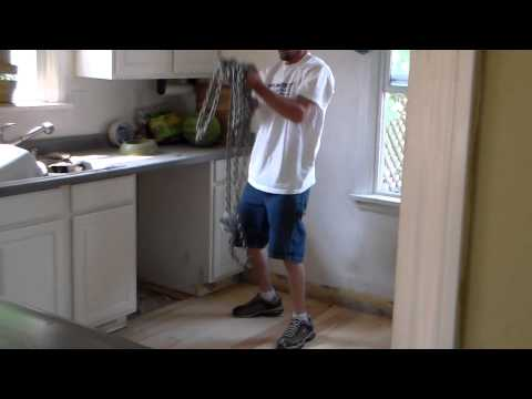 How to distress an old wood floor with a tow chain