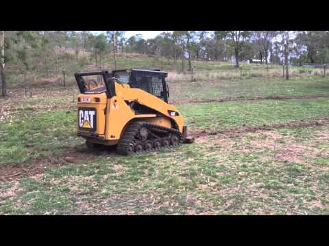 Swale building with Cat 257b skid steer loader