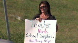 Teacher panhandles for school supplies money