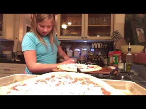 Making boboli pizzas with my friend