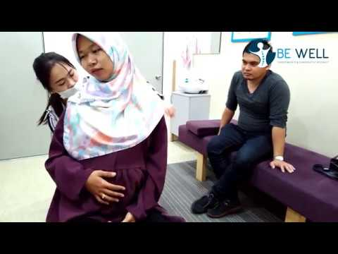 Pregnant Lady on Gonstead Chiropractic treatment
