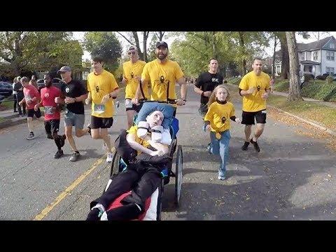 Friend Helps Paralyzed Buddy Compete In 5K