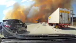 WATCH as people drive right through Los Angeles brush fires