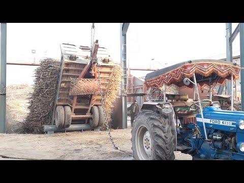 Ford 4600 on hydraulic jack with Heavy Sugarcane Loaded Trolley