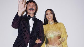 Kim Kardashian and Her Amazing Abs Channel Cher For Halloween:  See the Video!