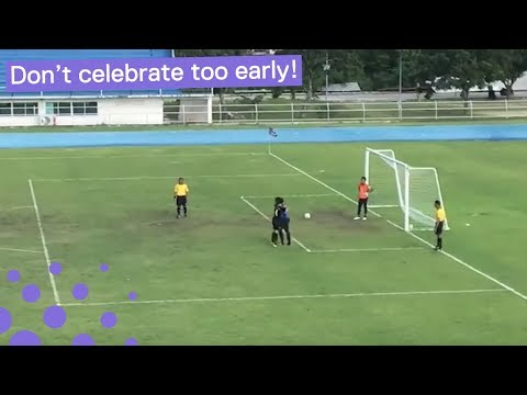 BALL BOUNCES INTO NET WHILE GOALKEEPER CELEBRATES PENALTY 'MISS'