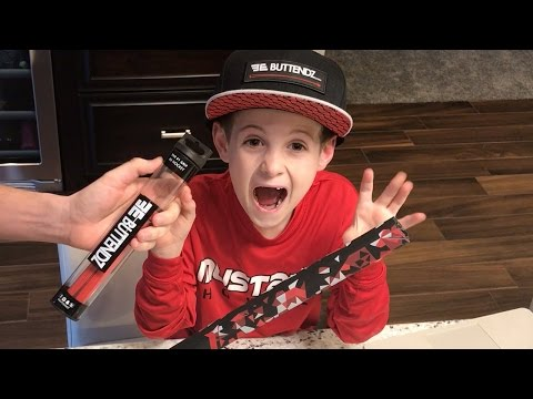 Kids HocKey  Putting BUTTENDZ on CArters hockey stick