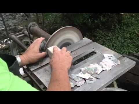 Polishing slabbed abalone.