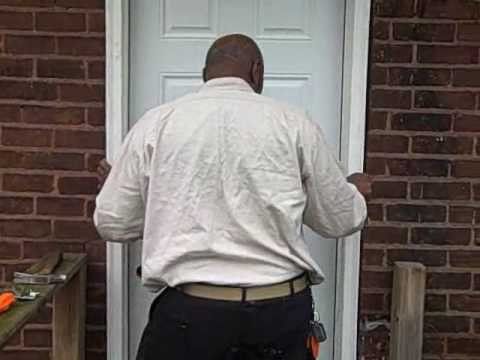 STEEL DOOR INSTALLED FOR YASU'S COURLAND PROPERTY,,CHEAP PROPERTY IN DETROIT.wmv