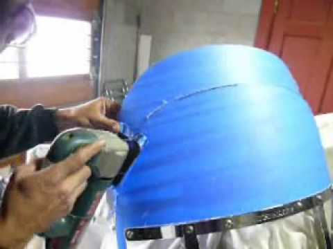 Trim a motorcycle windshield.