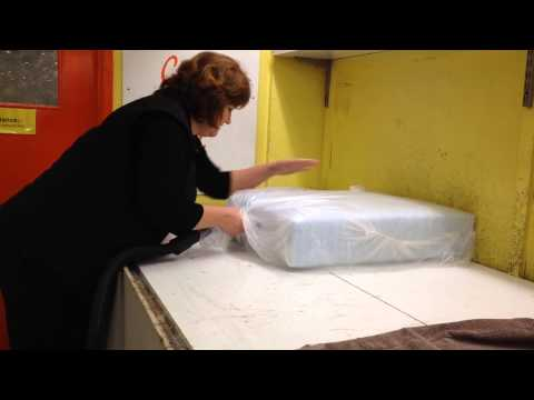 Fitting foam cushions in to covers using a vacuum