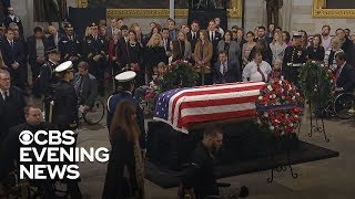 Bob Dole stands to deliver unforgettable salute to George H.W. Bush