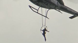 Crazy Ass Woman Hangs from Helicopter Above Niagara Falls by Her TEETH