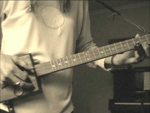 Learning to play cigar box guitar - picking
