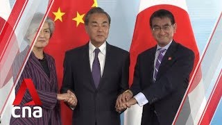 China, South Korea and Japan pledge to resolve tensions