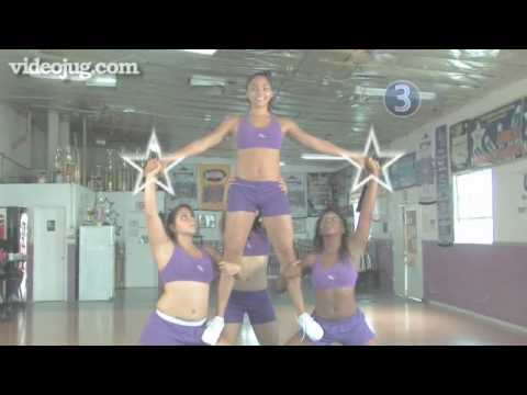 How To Do A Thigh Stand Stunt In Cheerleading