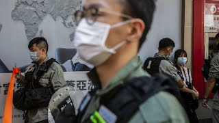 Hong Kongers march in silent protest at proposed national security law