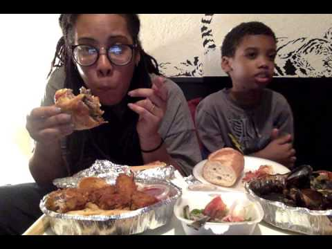 Ms Lil Big Appetite eating up an Italian Cheeseburger