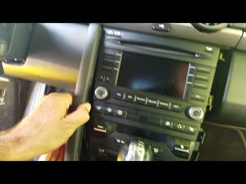 How to Remove Radio / CD Player from Porsche Cayman 2010 for Repair.
