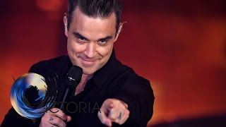 Robbie Williams tickets sold at higher prices - BBC News