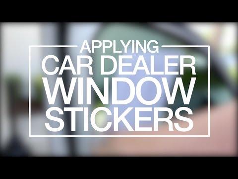 Applying Car Dealer Window Stickers