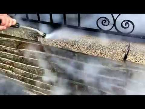 Stone wall cleaning using 150 degrees steam cleaner.