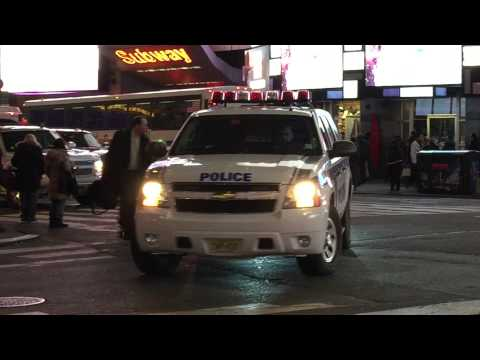 NY & NJ PORT AUTHORITY POLICE UNIT CRUISING BY ON 7TH AVE. IN TIMES SQUARE, MANHATTAN, NEW YORK.