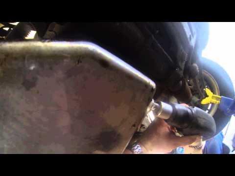 How to re-thread an oil pan drain plug.